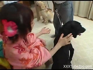 Japanese teen gets a lot of dog cock in her pussy and mouth
