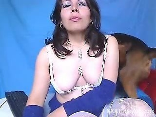 Busty cam babe shows off crazy scenes of real dog zoophilia porn