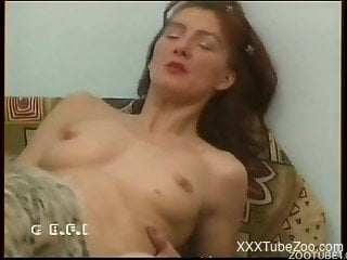 Lesbian woman in spicy scenes of dog fucking porn during home video