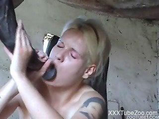 Busty blonde sure loves the huge horse cock smashing her vagina