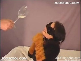 Masked girl is happy fooling around with domestic pet