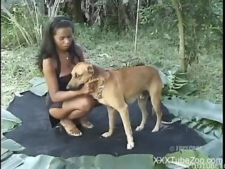 Beautiful young Mulatto woman fucked by dog outdoors