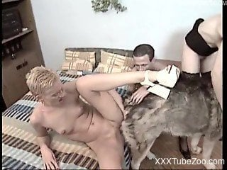 Redhead whore zoofil fucks with a dog in doggy style pose