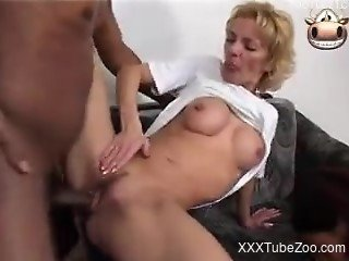 Short-haired MILF blonde fucks a dog and a dawg