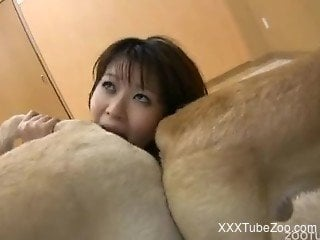 Asian slut stands naked and fucks with dogs