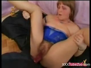 Fat bitch with a hairy cunt getting banged by a dog