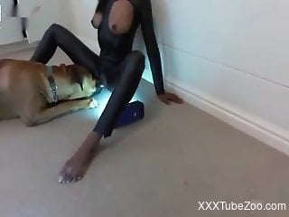 Catsuit-wearing slut getting fucked by her dog