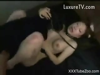 Asian woman gags with the dog's dick in crazy fetish XXX