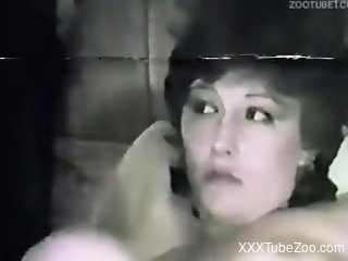 Dark-haired babe goes wild with a dog dick in her mouth