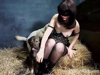 Brunette in a mask surrenders to a pretty pig cock
