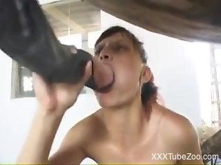Sneakers-wearing super-slut fucking a horny horse